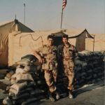 David and Eric Desert Storm in front of flag